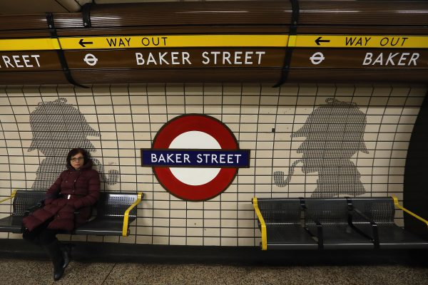 A passengers waits at Baker Street