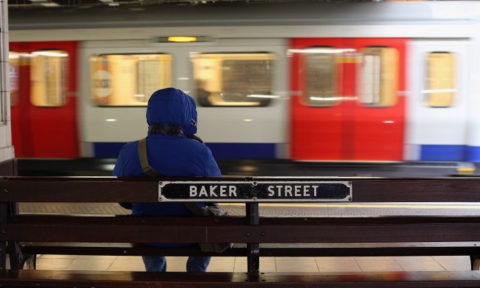 A passenger waits for a train at Baker Street Underground Station, London on Jan. 9, 2013. (Dan Kitwood/Getty Images)