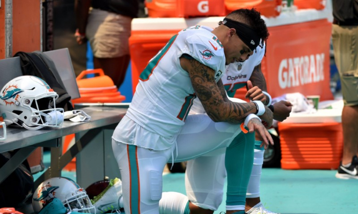 Miami Dolphins wide receiver Kenny Stills (left) and Dolphins wide receiver Albert Wilson (right) both kneel during the national anthem prior to a game against the Tennessee Titans at Hard Rock Stadium. Mandatory Credit: Steve Mitchell-USA TODAY Sports