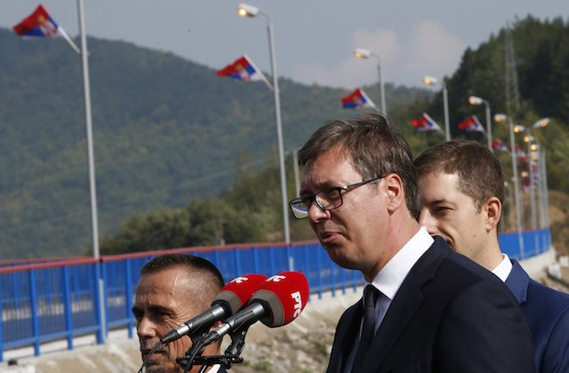 Serbian president Aleksandar Vucic, front, speaks during his visit to the Gazivode Dam near the village of Gazivode, Kosovo on Sept. 8, 2018. (AP Photo/Visar Kryeziu)