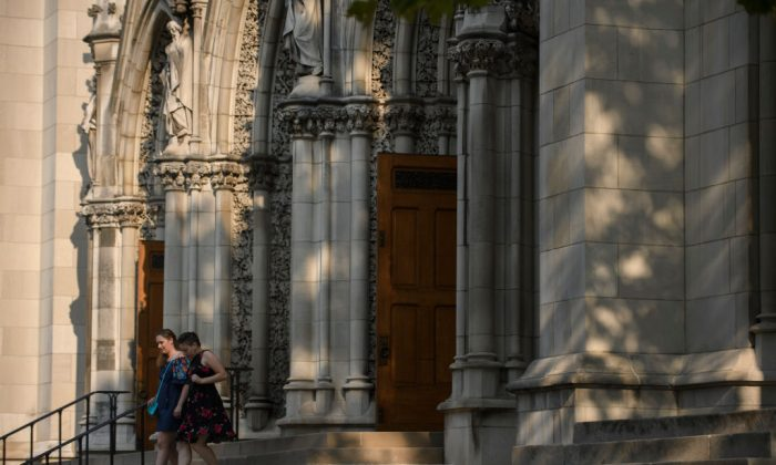 Parishioners leave St Paul Cathedral, the mother church of the Pittsburgh Diocese in Pittsburgh, Pennsylvania, on on Aug. 15, 2018. (Jeff Swensen/Getty Images)