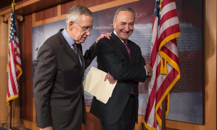 """Senate Majority Leader Harry Reid and Sen. Chuck Schumer leave after talking to reporters about the use of the """"nuclear option"""" at the U.S. Capitol on Nov. 21, 2013. (Chip Somodevilla/Getty Images)"""