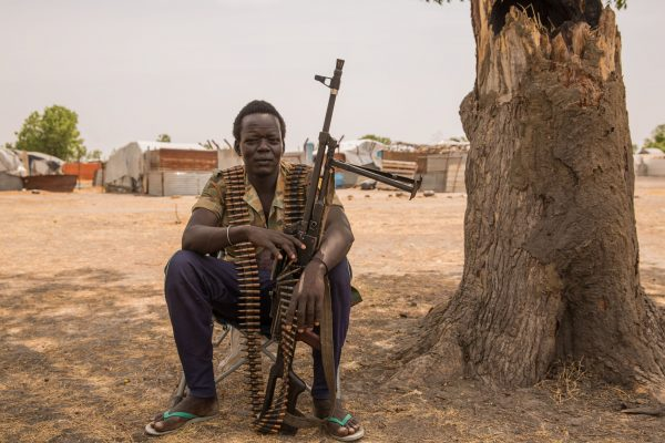 A government soldier poses with a gun on March 7, 2017, in Leer, South Sudan. (Stefanie Glinski/AFP/Getty Images)