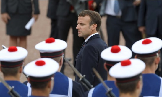 French President Emmanuel Macron reviews a troop of French sailors on June 18, 2018, at the Mont Valerien national memorial in Suresnes, outside Paris. (Ludovic Marin/AFP/Getty Images)
