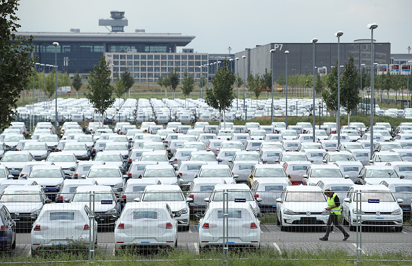 New Volkswagen cars stand parked on an open-air parking lot at BER Willy Brandt Berlin Brandenburg International Airport near Berlin on Aug. 14, 2018 in Schoenefeld, Germany. (Sean Gallup/Getty Images)