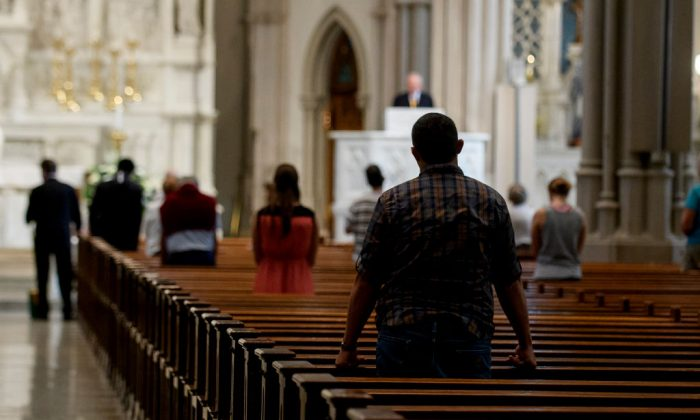 Parishioners worship during a mass to celebrate the Assumption of the Blessed Virgin Mary at St Paul Cathedral, the mother church of the Pittsburgh Diocese in Pittsburgh, Pennsylvania, on Aug. 15, 2018. (Jeff Swensen/Getty Images)