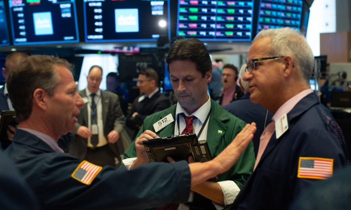 Traders work on the floor at the closing bell of the Dow Industrial Average at the New York Stock Exchange on Sept. 6. (BRYAN R. SMITH/AFP/Getty Images)