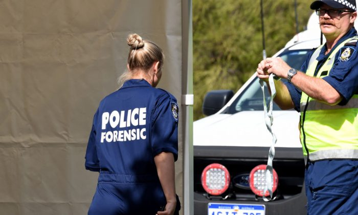 Forensic police examine a crime scene in the suburb of Australia's western city of Perth on Sept. 10, 2018. (Greg Wood/AFP/Getty Images)