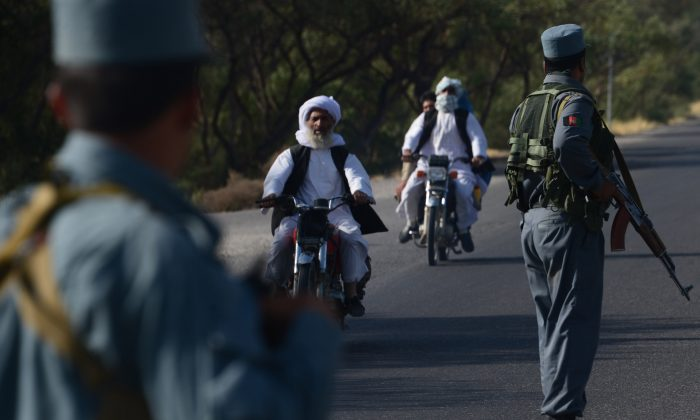 Afghan security forces stand at a checkpoint in western Herat province  Aug. 6, 2016.  (Aref Karmi/AFP/Getty Images)