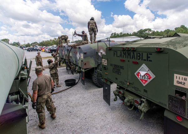 South Carolina National Guard soldiers transfer bulk diesel fuel into fuel tanker trucks