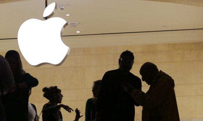 Apple is expected to unveil its biggest and most expensive iPhone yet on  Sept. 12, along with two smaller, cheaper versions in an attempt to widen the product's appeal amid slowing sales growth. (Mark Lennihan/AP)