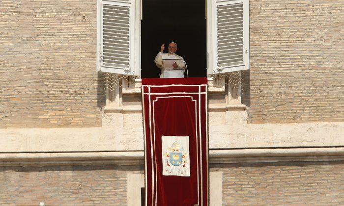 Pope Francis gives a short speech followed by the Angelus from the window of his apartment over St. Peter's Square in Vatican City, Vatican, on Sept. 02, 2018. (Spencer Platt/Getty Images)