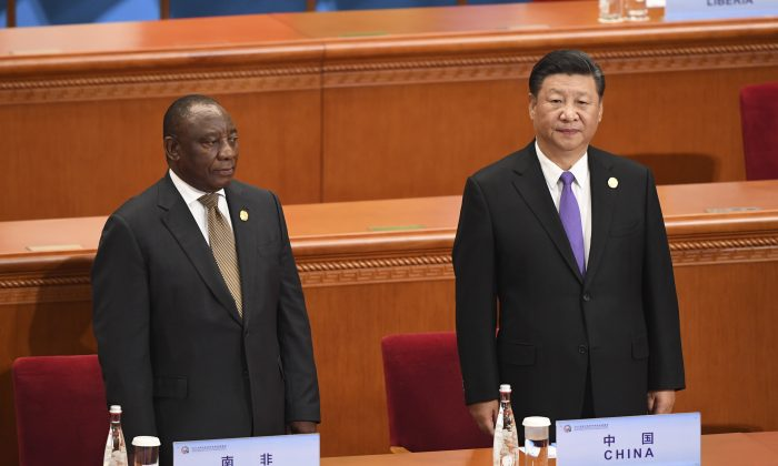 Chinese leader Xi Jinping, right, and South Africa's President Cyril Ramaphosa await other participants to arrive before the start of the opening ceremony of the Forum on China-Africa Cooperation at the Great Hall of the People on September 3, 2018 in Beijing, China. (Madoka Ikegami - Pool/Getty Images)