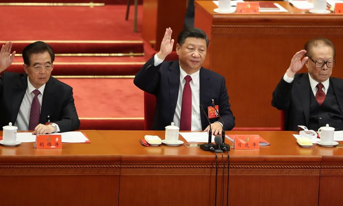 (L-R) The Chinese Communist Party's three most recent general secretaries: Hu Jintao (2002-2012), Chinese Xi Jinping (current) and Jiang Zemin (1989-2002) at the closing of the 19th Communist Party Congress in the Great Hall of the People in Beijing, China, on Oct. 24, 2017.  (Lintao Zhang/Getty Images)