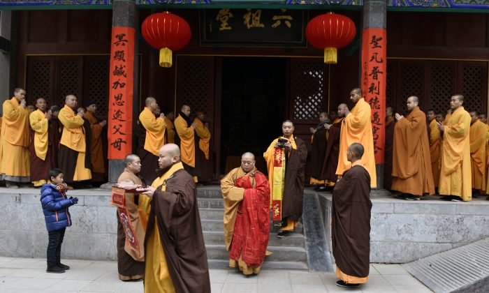 Chinese monks attend a ceremony at Shaolin Temple in Dengfeng, Henan Province, China, on Jan. 28, 2017. In an unprecedented move, the Chinese regime has required the temple to display a national flag in a show of loyalty to the Chinese Communist Party. (STR/AFP/Getty Images)