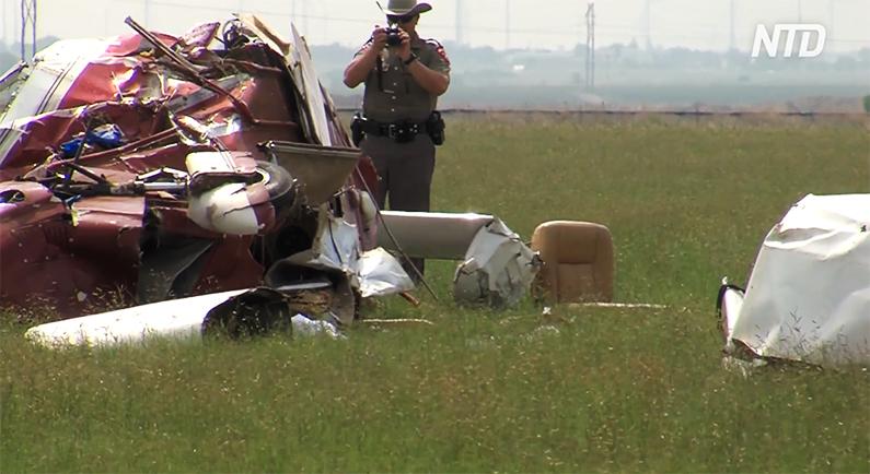 Investigators examine crash site.