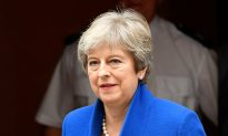UK PM May Promises Timetable in June for Her Exit Date
