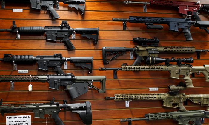 Firearms are shown for sale at the AO Sword gun store in El Cajon, Calif., on Jan. 5, 2016. (Mike Blake/Reuters)