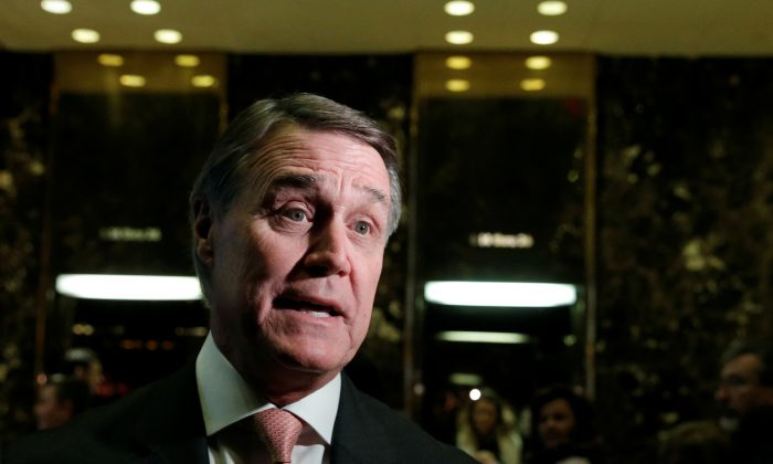U.S. Senator David Perdue (R-Ga.) speaks to members of the media after meeting with U.S. President-elect Donald Trump at Trump Tower in New York, U.S., December 2, 2016.   (Mike Segar/Reuters)