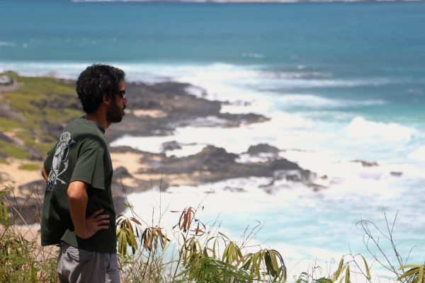A man looks out towards the ocean