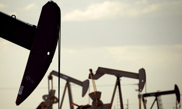 pumpjacks work in a field near Lovington, N.M In this April 24, 2015. The United States may have reclaimed the title of the world's biggest oil producer sooner than expected.  (Charlie Riedel/AP)