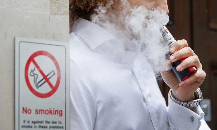 The stock photo shows a man vaping. (Tolga Akmen/AFP/Getty Images)
