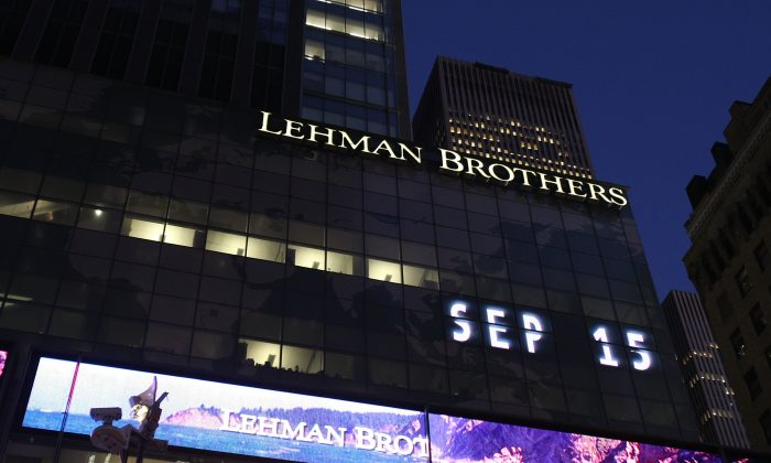 The Lehman Brothers' name is illuminated at its headquarters on Sept. 15, 2008, in New York City. (Mario Tama/Getty Images)