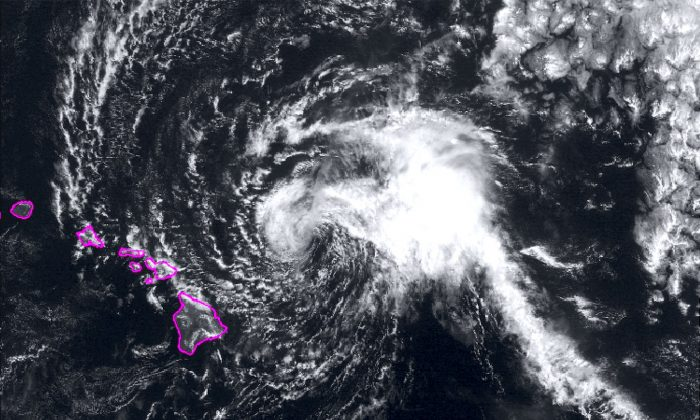This satellite image from the National Oceanic and Atmospheric Administration (NOAA) shows Tropical Storm Olivia east of the main islands of Hawaii at around 10 a.m. Hawaii time on Sept. 11, 2018. Meteorologists say the storm could deposit 10 to 15 inches of rain on the islands, though some areas could get as much as 20 inches. (NOAA via AP)