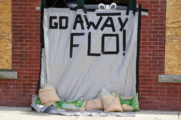 A message on a boarded up building ahead of hurricane Florence