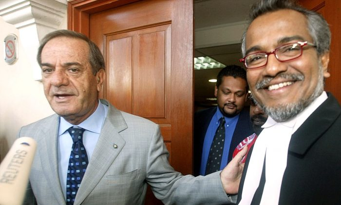 Italian National Quattrocchi Talks to Journalists As His Lawyer Muhammad Shafee Abdullah Smiles in Kuala Lumpur. (File photo/Reuters)