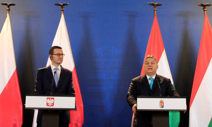 Polish Prime Minister Mateusz Morawiecki and Hungarian Prime Minister Viktor Orban hold a joint news conference in Budapest, Hungary, on Jan. 3, 2018. (Bernadett Szabo/Reuters)
