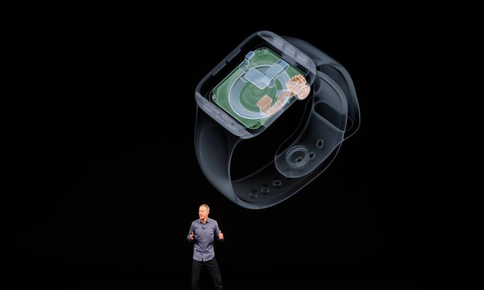 Jeff Williams, Chief Operating Officer of Apple, speaks about the new Apple Watch Series 4 at an Apple Inc product launch event at the Steve Jobs Theater in Cupertino, California, on Sept. 12, 2018. (Reuters/Stephen Lam)