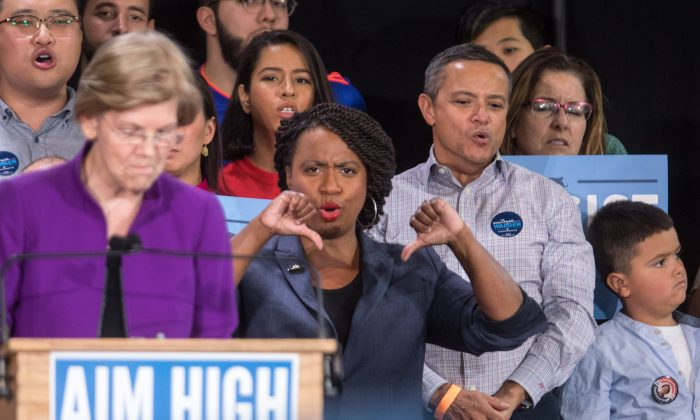 Boston City Council member Ayanna Pressley (R) gestures at a rally attended by U.S. Sen. Elizabeth Warren (D-MA) and Democratic gubernatorial candidate Jay Gonzalez on Sept. 9, 2018, in Cambridge, Massachusetts. (Scott Eisen/Getty Images)
