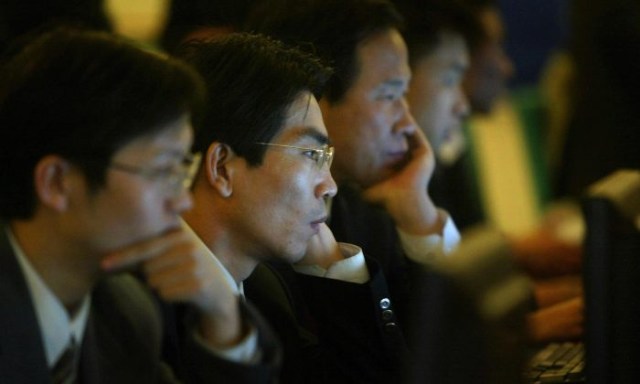 National People's Congress delegates surf the internet in Beijing, China on March 14, 2004. (FREDERIC J. BROWN/AFP/Getty Images)