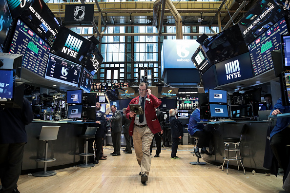 Traders and financial professional work on the floor of the New York Stock Exchange (NYSE) ahead of the closing bell, May 15, 2017 in New York City. (Drew Angerer/Getty Images)