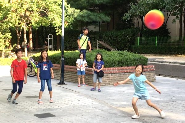 Children play at the Gireum New Town Apartment complex in Seoul on Sept. 9, 2018. (Seungmock Oh/Special to The Epoch Times)