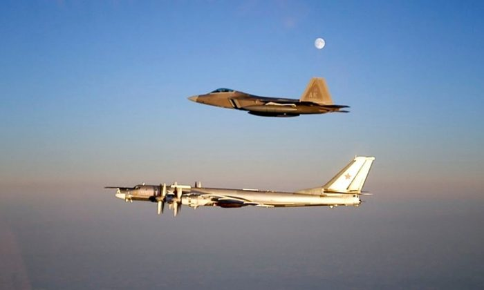 An F-22 Raptor escorts a Russian TU-95 Bear flying near the Alaskan NORAD Region airspace in a file photo. (Air Force)