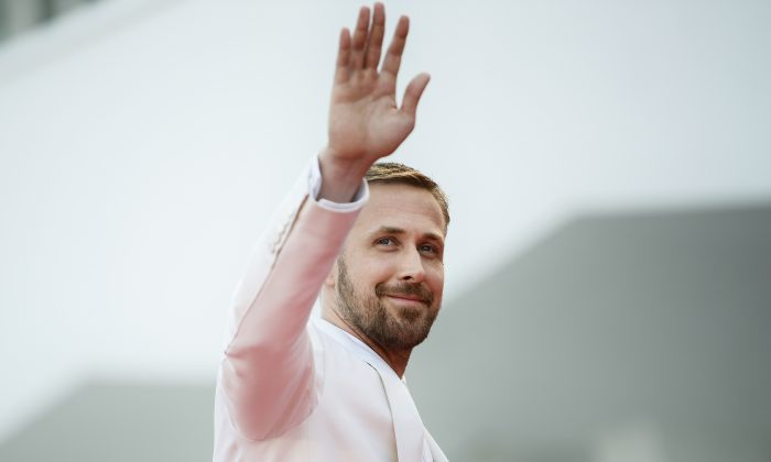 "Actor Ryan Gosling waves as he arrives for the opening ceremony and the premiere of the film ""First Man"", presented in competition at the 75th Venice Film Festival at Venice Lido, on Aug. 29, 2018.         (Filippo Monteforte/AFP/Getty Images)"