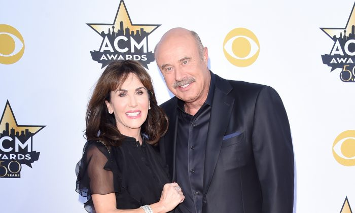 Dr. Phil and Robin attend the 50th Academy of Country Music Awards at AT&T Stadium in Arlington, Texas on April 19, 2015. (Jason Merritt/Getty Images)