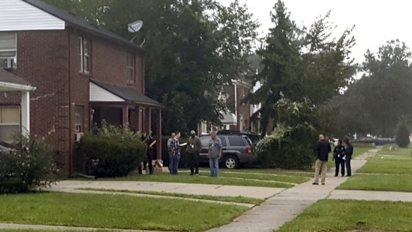 Police gather at a Detroit home