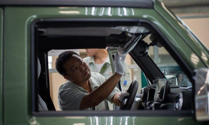 A worker on an car production line is seen at the BAIC (Beijing Automotive Group Co.) assembly plant in Beijing, on Aug. 29. (Nicolas Asfouri/AFP/Getty Images)