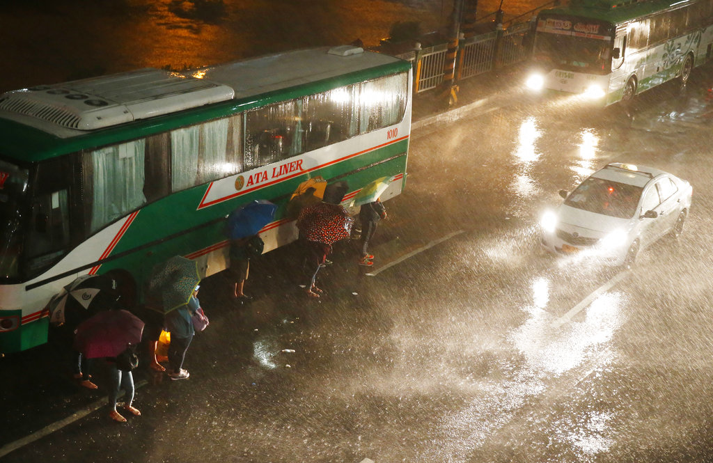 People evacuating in heavy rain
