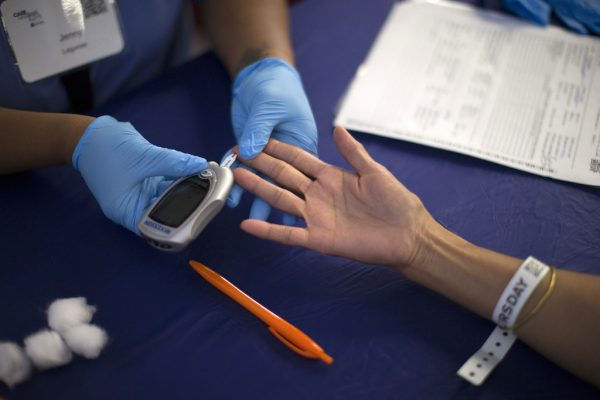 FILE PHOTO - A person receives a test for diabetes during Care Harbor LA free medical clinic in Los Angeles, California September 11, 2014. REUTERS/Mario Anzuoni