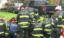 Firefighters Kneel and Pray at Site Where Mother and Baby Killed by Hurricane Florence