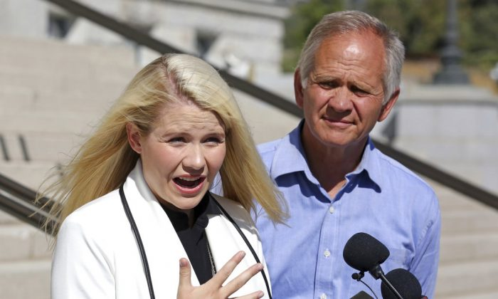 Elizabeth Smart speaks during a news conference while her father Ed Smart looks on Thursday, Sept. 13, 2018. (AP Photo/Rick Bowmer)