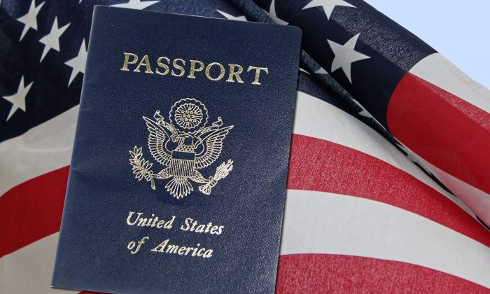 A United States passport is pictured with the country's flag. (Public Domain)