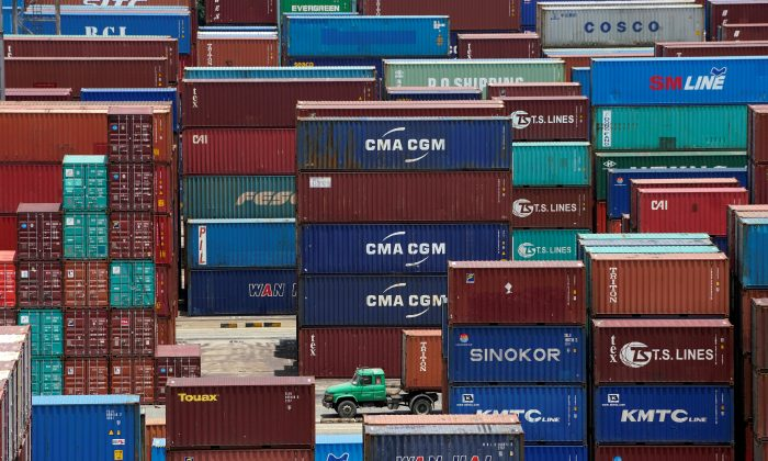 Shipping containers are seen at a port in Shanghai, China July 10, 2018. (Aly Song/Reuters)