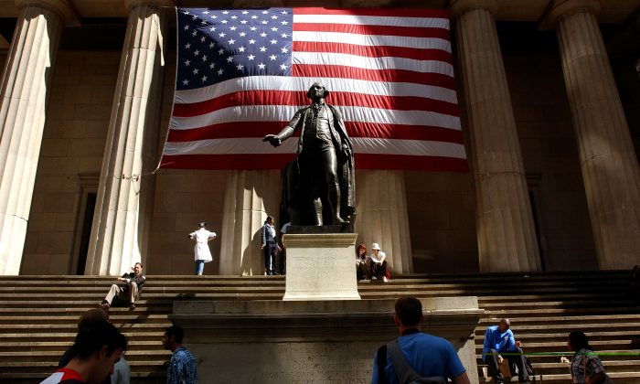 An American flag is displayed behind a statue of George Washington in a Sept. 2002 file photo in New York City. (Spencer Platt/Getty Images)