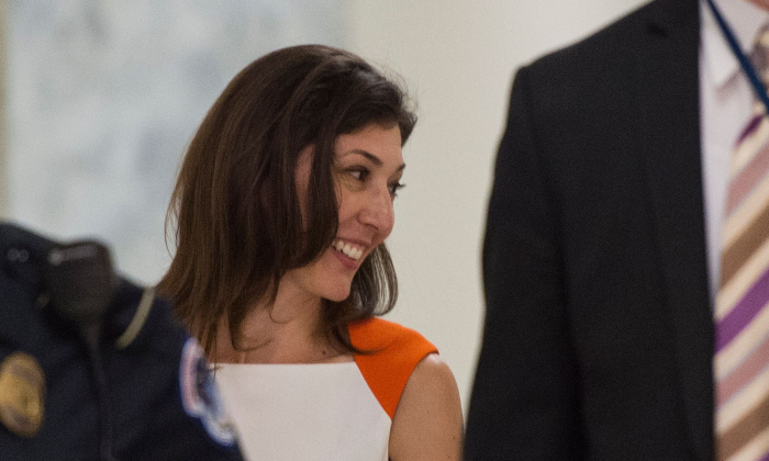 Lisa Page (C), former legal counsel to former FBI Director Andrew McCabe, arrives on Capitol Hill to speak before the House Judiciary and Oversight Committee on July 16, 2018. (ANDREW CABALLERO-REYNOLDS/AFP/Getty Images)