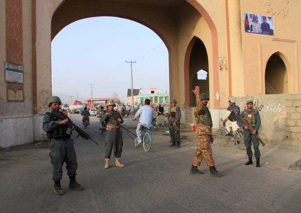 Afghan policemen keep watch